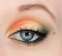 Subtle orange eye makeup, got to try this!  This poor girl needs to grow her eyebrow back though. She got a little carried away with the plucking. lol.