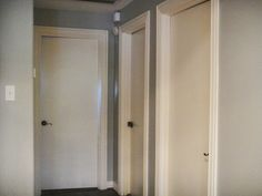 Possible option for foyer. Gray wall paint, white door combo.