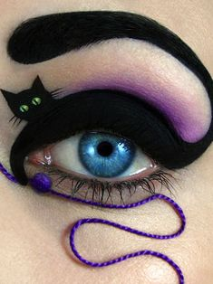 Literal Cat Eye Makeup/Fashion by Tal Peleg - i called this eye fashion so i could pin this unique and gorgeous makeup - not just for Halloween, you could wear this out clubbing, dancing anytime. Right??