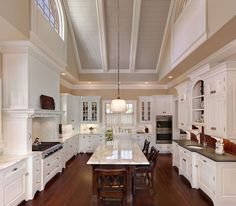 Large rooms that have high ceilings, such as this beautiful kitchen are not that warm or homey, and they happen to look impersonal despite of the effort you invest to furnish them. Most of the time, efforts will lead to a half-empty room, and you'll have no idea what to do next. Experimenting with deeper shades is allowed in this case, because it helps you balance even the biggest and most open space. We recommend soft sheens of rich cocoa, pearl or eggshell. #kitchens