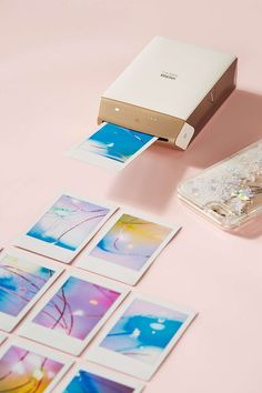Fujifilm Instax Share SP-2 Smartphone Instant Printer. This would be awesome to have to save pictures/memories and I could pick and chose which picture to print out. Much better than the Instax camera.