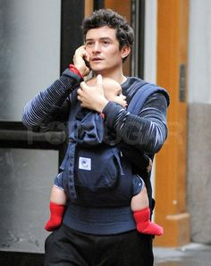 Orlando Bloom kept Flynn close as they took care of business in NYC.