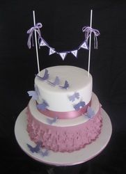 Naming day cake. 2 tier mauve ruffle cake with fondant butterflies and bunting.
