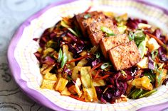 Spicy Baked Marinated Tofu with Vibrant Cabbage Stir Fry Recipe Main Dishes with extra firm tofu, extra light olive oil, Cholula Hot Sauce, low sodium soy sauce, onion powder, garlic powder, smoked paprika, sesame oil, cooking wine, sea salt, ground pepper, extra light olive oil, green cabbage, red cabbage, carrots, sea salt, smoked paprika, red pepper flakes, cayenne pepper, rice vinegar, low sodium soy sauce, white sesame seeds, scallions