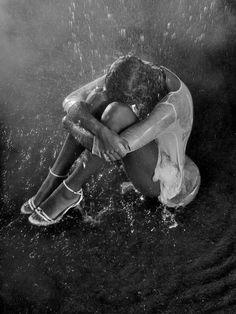 feeling the water wash away her dark mood.