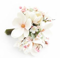 A large posy of pearl magnolias, dusty miller and cherry blossom.