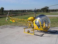 Cool picture of a Bell 47 Helicopter painted yellow.