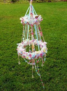 Beltane inspired flower chandelier: this would look awesome in Violet's room!