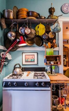 Small Kitchens: Utilizing Space - Moon to Moon Hanging Pans! I need one of these for my kitchen
