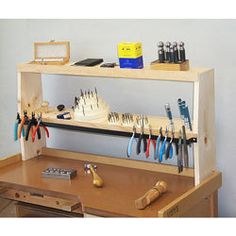 "Convenient way to organize tools while keeping your bench clear to do work. Fits on the back of most jewelers benches. Measures 35""W x 17 1/4""H x 5 1/2""D"