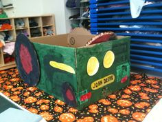 During our farm unit we talked about tractors, watched video clips of them in action and made this fabulous John Deere out of a Weber grill box
