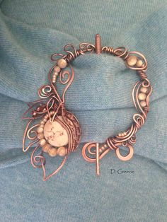 Copper brooch with Mother of Pearl and Magnesite.