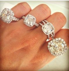 cushion cut diamond engagement rings. I love them all except for the big one... that's a little too much lol