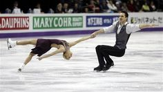 Tatiana Volosozhar and Maxim Trankov, of Russia, perform during the pairs short program at the World Figure Skating Championships Wednesday, March 13, 2013, in London, Ontario. DARRON CUMMINGS — AP Photo