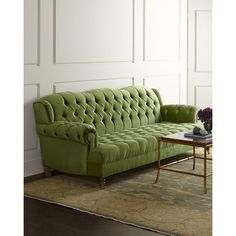 An elegant silhouette, rolled arms, and tufted upholstery in a vibrant hue make this sofa a bold choice for any room. Hardwood frame. Rayon/cotton velvet uphol…