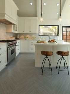 White kitchen, wood tile herringbone floor
