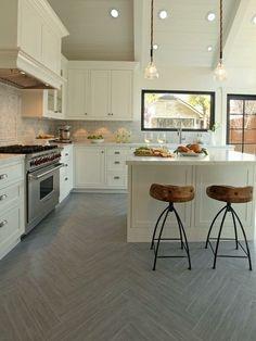 White kitchen, wood tile herringbone floor