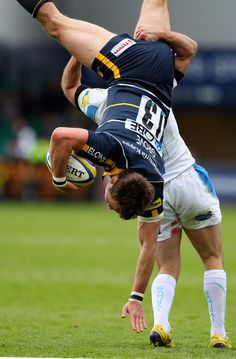 Alex Grove of Worcester is up ended in a tackle by Gonzalo Camacho of Exeter resulting in a yellow card during the Aviva Premiership match between Worcester Warriors and Exeter Chiefs at Sixways Stadium on April 14, 2012 in Worcester, England. - 12 of 26