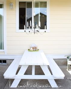 I LOVE the light fixture above the white picnic table!  ...Also, I think this has inspired me to paint our picnic table white this summer if the hubby will let me ;-)