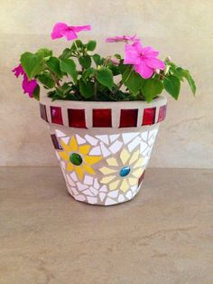 A personal favorite from my Etsy shop https://www.etsy.com/listing/235250570/mosaic-flower-pot-indoor-outdoor-planter