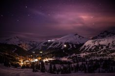 A starry sky over snow-cloaked Sunshine Village, Banff National Park, Alberta