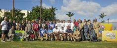 140122-N-FF306-100 PEARL HARBOR (Jan. 22, 2014) NFL players and professionals pose for a photo with service members on Joint Base Pearl Harbor-Hickam. This event was a part of the NFL's on-going Play 60 campaign which encourages kids to be active for at least 60 minutes a day. (U.S. Navy photo by Mass Communication Specialist Seaman Apprentice Rose Forest/Released)