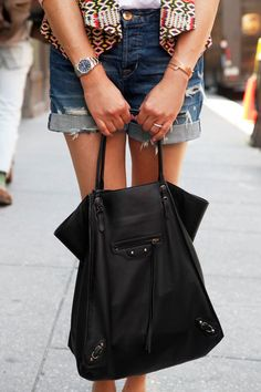 NYC #streetstyle #Balenciaga bag, Hudson shorts, #Rolex watch, and Rebecca Minkoff jacket