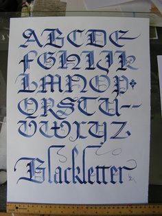 I don't know if this counts as a full blackletter, but it does have the same style despite being in blue. But this does point out to me that I can use the styles I learn with black ink with other ink colors. Calligraphy Letters Alphabet, Tattoo Fonts Alphabet, Calligraphy Words, Hand Lettering Alphabet, Learn Calligraphy, Caligraphy, Gothic Lettering, Graffiti Lettering Fonts, Chicano Lettering