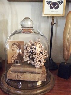 Home decor display idea - cloche on wooden stand. Remembering someone you love by displaying some of their things. Great idea!