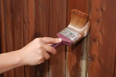 How to help your wood fence go the distance. Upgrading to a nice board-on-board fence can make a dramatic difference in the appearance of your backyard. Staining Wood Fence, Fence Stain, Stain Wood, Painted Outdoor Furniture, Diy Casa, Paint Stain, Backyard Projects, Diy Projects, Outdoor Projects