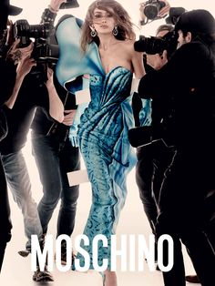 MOSCHINO\\\'S SPRING 2017 CAMPAIGN FEATURES GIGI AND BELLA HADID AS REAL-LIFE PAPER DOLLSBY SHAYLA KELLYThe campaign, shot by Steven Meisel and styled by Carlyne Cerf de Dudzeele, features the sister duo in paper doll dresses while in a sea of paparazzi. The collection, inspired by paper dolls, features trompe l\\\'oeil ...
