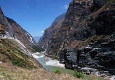 Tiger Leaping Gorge – China:  One of the deepest gorges in the world, it clocks in at about 9.3 miles long and 18,360 feet deep in between the snow-covered peaks of the Jade Dragon Snow Mountain and the Haba Snow Mountain. Backpackers can spend anywhere from three days to a week trekking the narrow winding trails beneath waterfalls and through pine and bamboo forests, visiting quiet rural villages along the way.