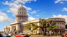 Historic Cuban #architecture with #vintage cars still on the road