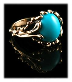 Sleeping Beauty Lost Wax Turquoise Ring in Gold by Nattarika Hartman of Durango Silver Company.