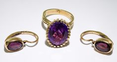 Lot 193: 14k Gold, Mystic Topaz and Amethyst Jewelry Assortment; Including a ring having an oval cut mystic topaz in a high setting and pierced earrings having oval cut amethyst; earrings marked (Russian) 56