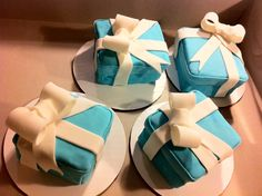 Tiffany box cakes - Made these for a bridal shower. Bride loves Tiffany and co. Inside is red velvet with cream cheese filling. My first time to make boxes, It's a lot of work I need to watch some videos to get better at it. My client loved these though :). all fondant with fondant bows