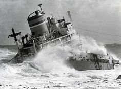 The S. A. Seafarer after a month. | Big seas continued to pound the wreck of the Seafarer off Mouille Point. A month after the disaster ( 1 July '66) her port side has been smashed down and the superstructure rests on the engine and boilers. Photo; The Argus