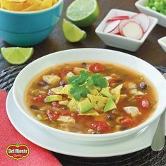 Curl up with a steaming, savory bowl of Tortilla Soup. It's both light and filling, perfect for cold nights!