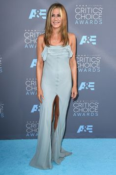 Jennifer Aniston wore a Saint Laurent by Hedi Slimane gown with Jimmy Choo heels. #CriticsChoiceAwards #RedCarpet