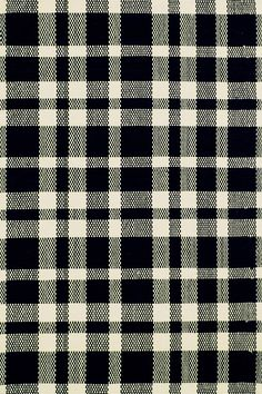 Bring on-trend gingham style to your floors with a durable woven cotton rug in black and ecru.