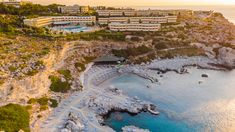 Luxury Hotel Resort with Swimming Poll and Beach Located at Cliffs in Rhodes, Greece. Greece Travel, Rhodes, Swimming, River, Mansions, Luxury, House Styles, Beach, Free