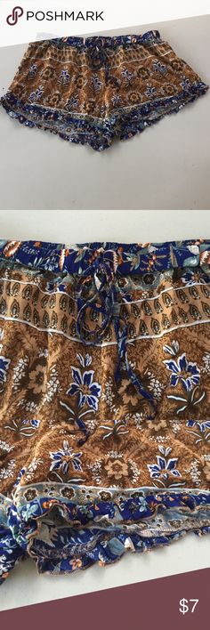 Bohemian shorts These are so cute!!  They say large but for more like a very small medium. Waist to crotch is 9 inches. Inseam is 3 inches. Waist measures 30 inches but has elastic stretch. Tie at waist. Cotton candy Shorts