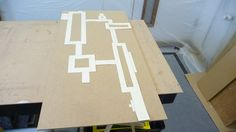 The Cubus / Quebus Template over the top of the wood in which I will cut out from.