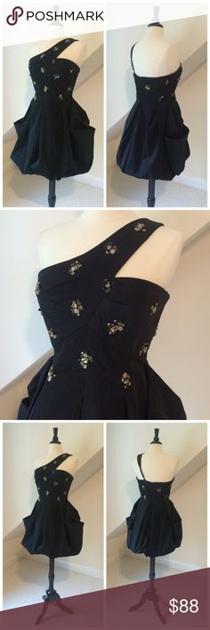 BCBGMaxAzria Party Dress BCBGMaxAzria Party Dress...pouf skirt with fitted bodice...single cross-over adjustable strap...embellished with cocoa rhinestones and beads, black sequins and gold charms...back zipper...hand wash. Excellent pre-loved condition. Retail $329 BCBGMaxAzria Dresses One Shoulder