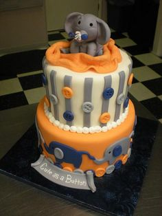 Baby shower cake - in grey and perhaps I would pick another color besides orange.
