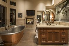 Craftsman Master Bathroom with Dura Supreme Cabinetry Craftsman Panel, European Cabinets, Limestone counters, High ceiling