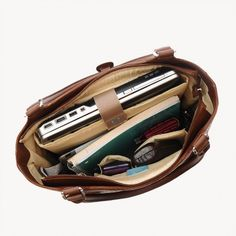 Our full-sized, fashionable, fully featured carry bag handles everything your busy day requires. Great for business travel! The Leather Laptop Tote from Jill-e Designs is a great everyday bag that off