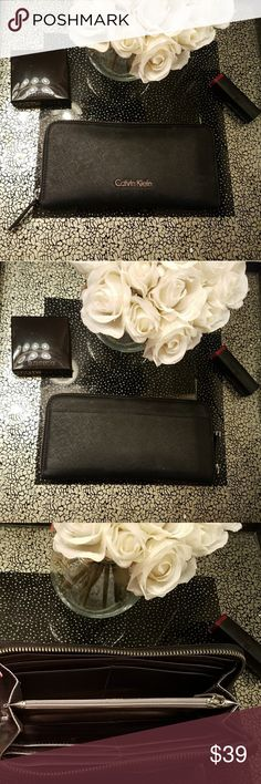 Calvin Klein Black Wallet Cute Calvin Klein Black Wallet with a zipper Calvin Klein Bags Wallets