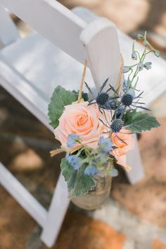 ceremony chair flowers - photo by Artistrie Co http://ruffledblog.com/leo-carrillo-ranch-barbecue-wedding