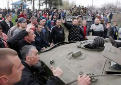 EUSA FASCIST UKRAINE ARMY DISARMED BY PEOPLE POWER  http://brev.is/idH8 …